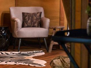 YALA_Aurora_interior_seat_with_table - Safari tents and glamping lodges