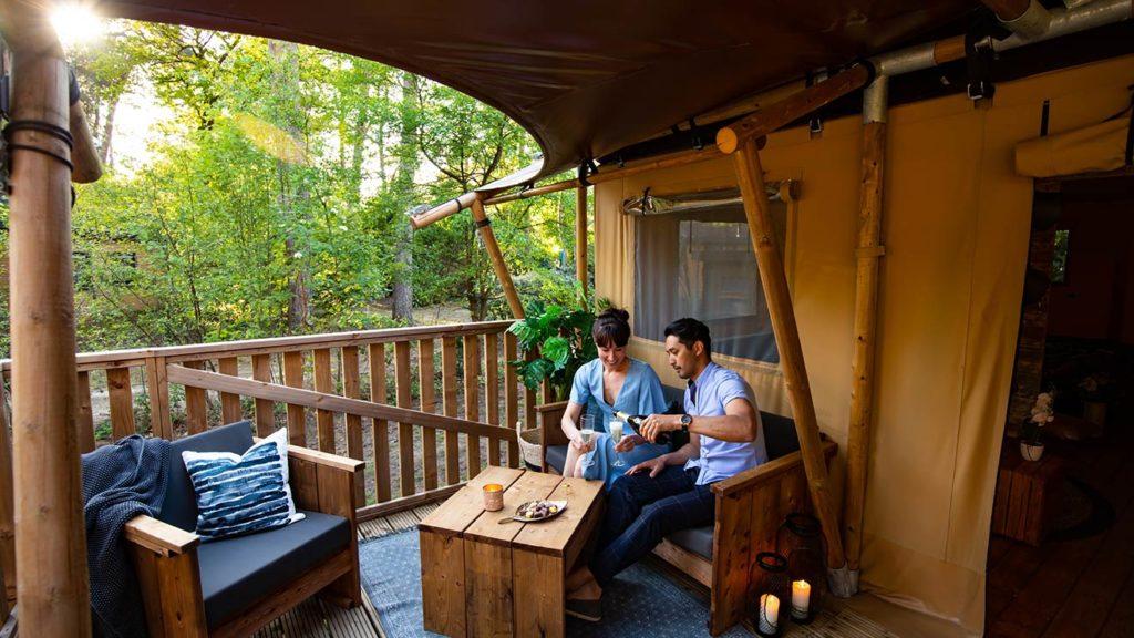 YALA_Dreamer_couple_on_veranda_landscape - Safari tents and glamping lodges