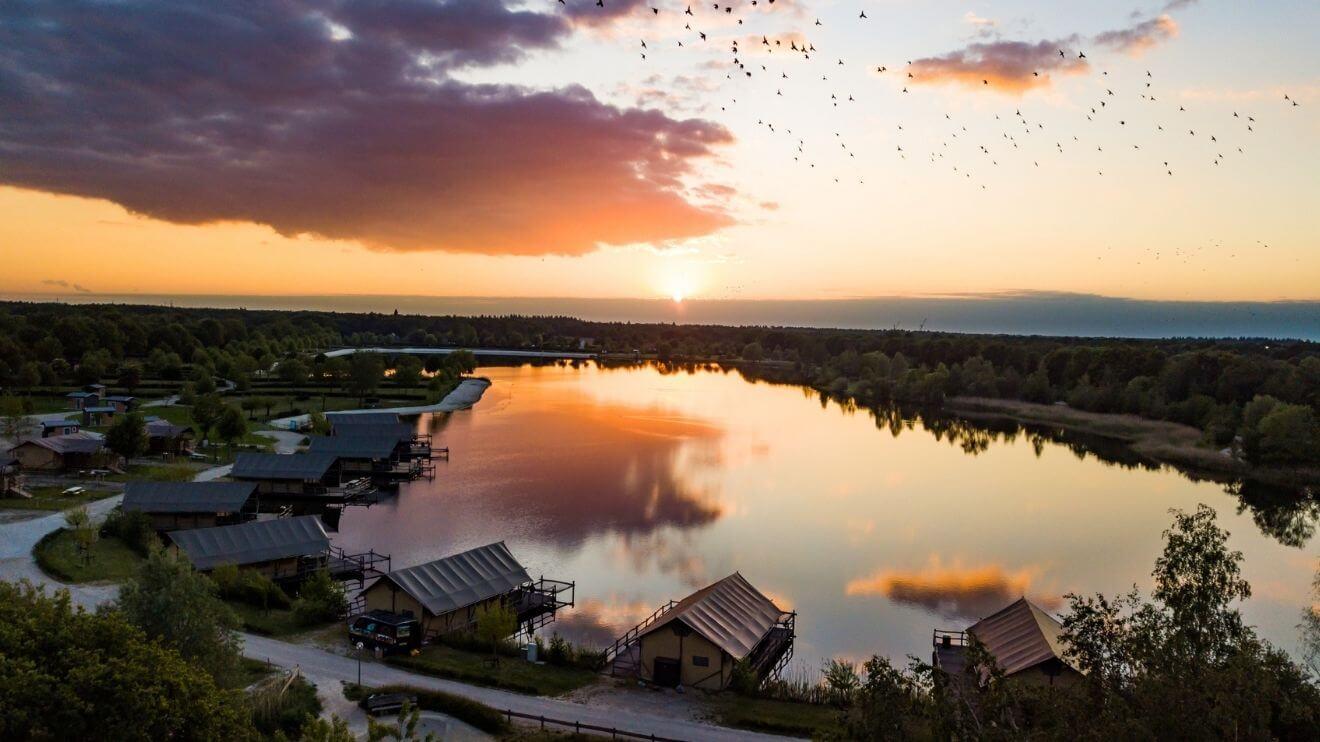 YALA_luxury_canvas_lodges_TerSpegelt_Netherlands_at_the_lake_sunset