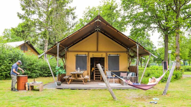 YALA_Glamping_Lodges_exterior_with_couple_landscape