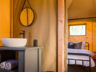 YALA_Twilight_safari_tent_bathroom-and-bedroom - safari tents and glamping lodges