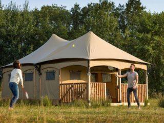 YALA_Twilight_safari_tent_couple_playing_badminton - safari tents and glamping lodges