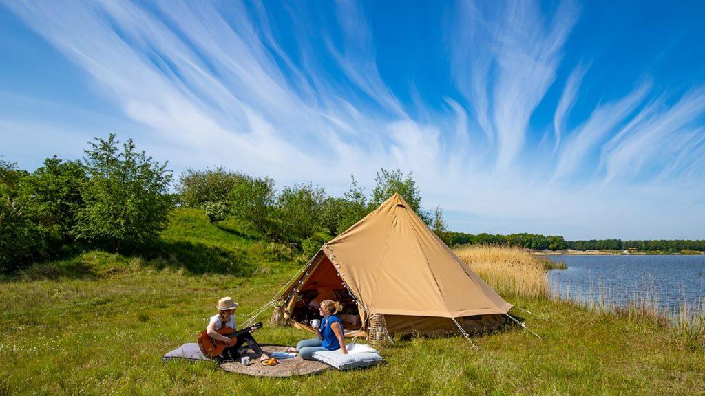 YALA_BellTent_at_EigenWijze_Netherlands_couple_before_tent_landscape